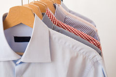 Shirts in several colors and textures Stock Photos
