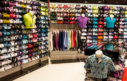 Shirts shop interior. Shelves of different colors shirts for men in shop royalty free stock photos