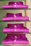 Shirts. Violet fashion shirts in modern showcase stock image