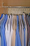 Shirts in wardrobe. Men´s shirts hanging in cabinet Royalty Free Stock Images