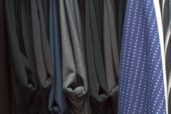 Shirtsleeves And Pants In A Closet Stock Photo