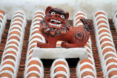 Shisa guardian from Kingdom of Ryukyu on the roof in Okinawa. Japan Royalty Free Stock Photography