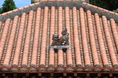 Shisa guardian from Kingdom of Ryukyu on the roof in Okinawa. Japan Stock Photo