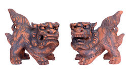 Shisa Guardians from Okinawa. A pair of clay Okinawan lion dogs, also called shisa; isolated on white Royalty Free Stock Photography