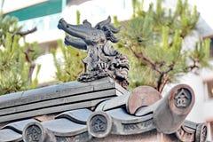 Shisa lub Shishi, Japoński męski lwa ` s szczęki wizerunek dla szczęsliwego obrazy stock