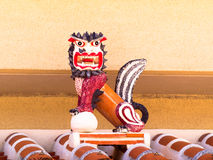 Shisa on the plaster roof Royalty Free Stock Image