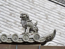 Shisa or Shishi ,Japanese male lion`s shut image for prevent bad Stock Photo