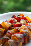 Shish kabob. With onion, red meat, yellow and red peppers Stock Image