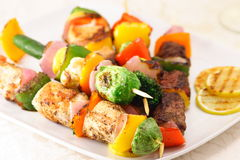 Shish kabob. Assorted meats shish kabobs fine served Royalty Free Stock Photo