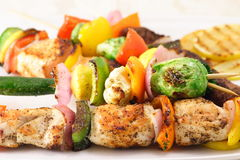 Shish kabob. Fine  plate full of shish kabobs garnished with vegetables Stock Images