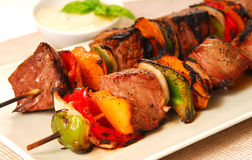 Shish Kabobs. Freshly grilled shish kabobs with a horseradish dipping sauce Royalty Free Stock Images