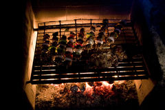 Shish Kabobs and Steak on Grill Stock Image