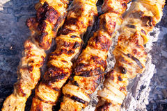 Shish kebab. Cooking shish kebab on the open air Royalty Free Stock Photo