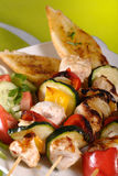 Shish Kebab. Shish made of chicken, onion, zucchini and pepper grilled Royalty Free Stock Images
