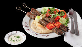 Shish Kebab. Barbecued shish kebab on pita bread Royalty Free Stock Photography