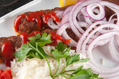 Shish kebab. With rice onions Stock Photography