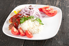 Shish kebab. With rice onions Stock Photos