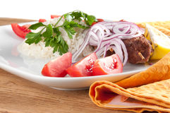 Shish kebab. With rice onions Royalty Free Stock Photo