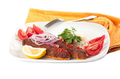 Shish kebab. With rice on a white background Stock Photo