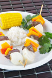 Shish kebab. Served with cooked white rice and corn on the cob Royalty Free Stock Photography