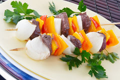 Shish kebab. Grilled shish kebab made of sirloin steak, bell peppers, sweet vidalia onions and garnished with Italian parsley Stock Photography