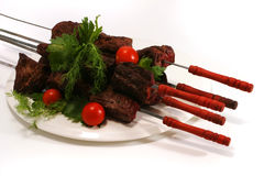 Shish kebab on dish Stock Photos