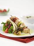 Shish kebab and filled tortilla Royalty Free Stock Image