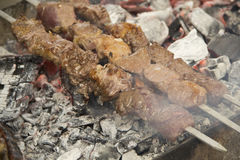 Shish kebab on fire. Ready for lunch Royalty Free Stock Photo