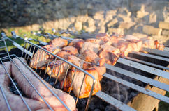 Shish kebab on the grill with smoke Stock Image