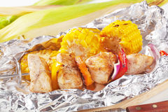 Shish kebab and grilled corn Royalty Free Stock Photos