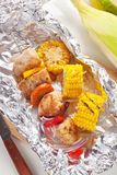 Shish kebab and grilled corn Stock Images