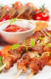 Shish kebab with herbs on a white plate Stock Photography