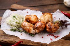 Shish kebab with marinated onions garnishing. Grill bar, tasty chicken meat. Shish kebab with marinated onions garnishing on wooden board. Summer delicious food stock images