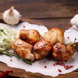 Shish kebab with marinated onions garnishing. Grill bar, tasty chicken meat. Shish kebab with marinated onions garnishing on wooden board. Summer delicious food royalty free stock photo