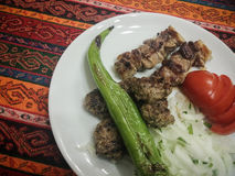 Shish kebab and meatballs Stock Images