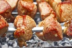 Shish kebab on metal skewers close-up Royalty Free Stock Photo