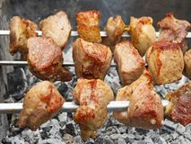 Shish kebab on metal skewers Stock Photography