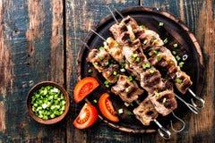 Shish kebab na drewnianym tle Zdjęcia Stock