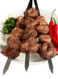 Shish kebab with parsley, paprika and cake on whit Royalty Free Stock Photography
