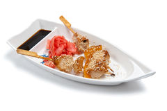 Shish kebab on a plate in the form of a boat Stock Images