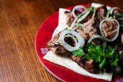 Shish kebab on a plate stock image