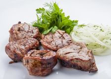 Shish kebab from pork tenderloin with onion stock images