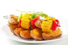 Shish kebab and potato wedges Stock Photography