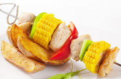 Shish kebab and potato wedges Royalty Free Stock Photo