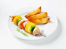 Shish kebab and potato wedges Royalty Free Stock Image