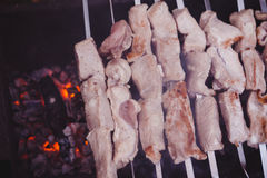 Shish kebab preparing on fire Royalty Free Stock Photography