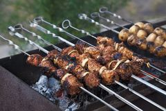 Shish kebab in process of cooking Royalty Free Stock Images