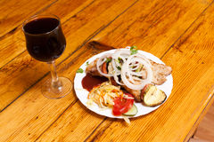 Shish kebab and red wine, home dinner Royalty Free Stock Image