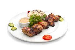 Shish kebab with rice and mushrooms. Served shish kebab with rice and mushrooms Royalty Free Stock Images
