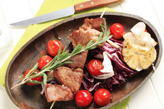 Shish kebab and roasted vegetables Stock Images